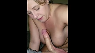Milf giving a fan a nice blowjob in front of hubs